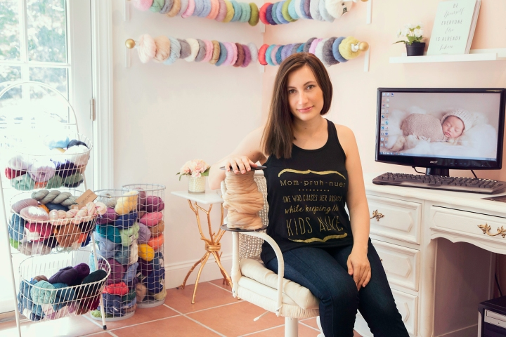 Mila in her studio.  Love all of the light and the soft colors she decorated with!